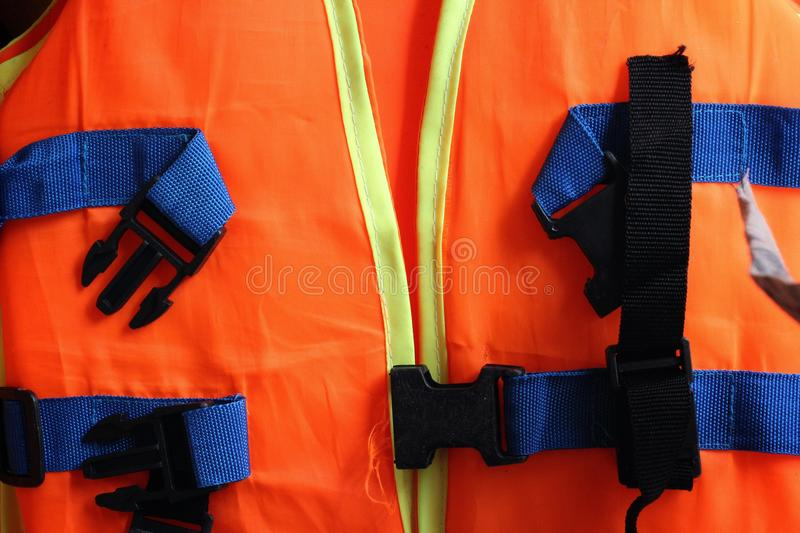 Orange life jacket. On the clothes line stock photography