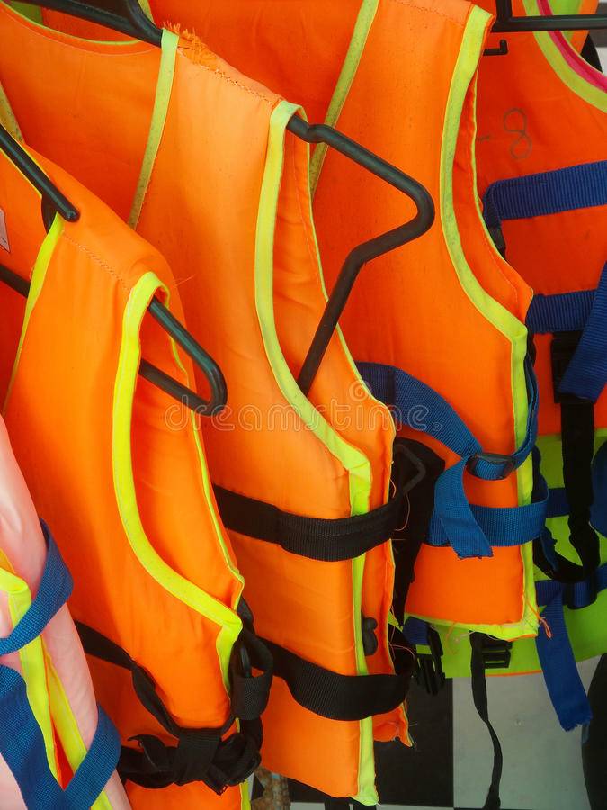 Orange life jacket. On the clothes line royalty free stock photography