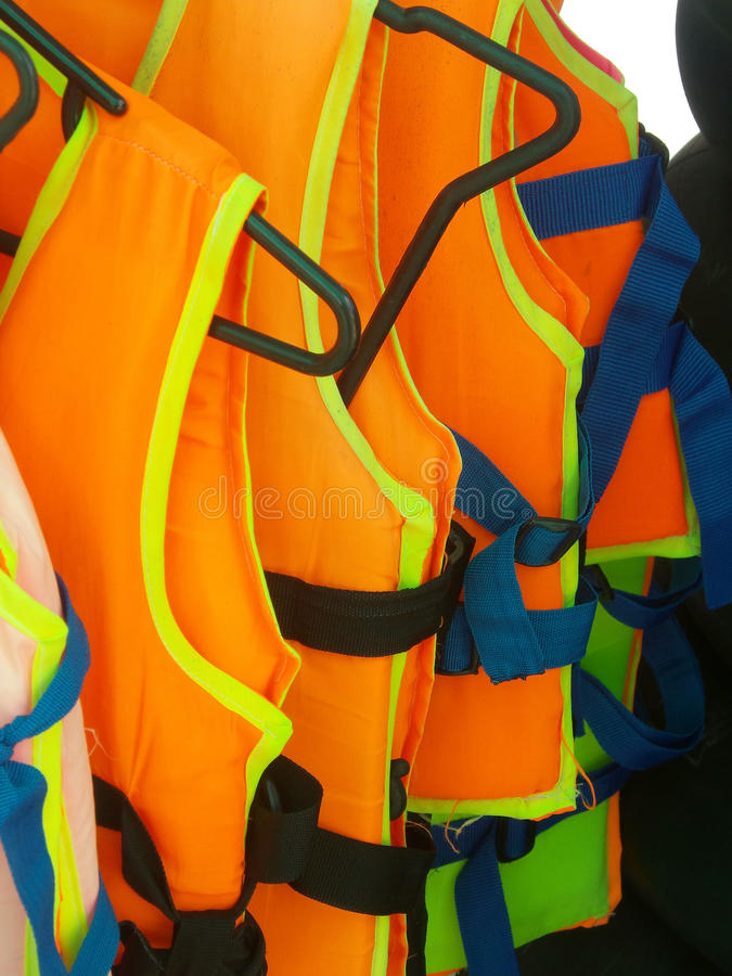 Orange life jacket. On the clothes line stock images