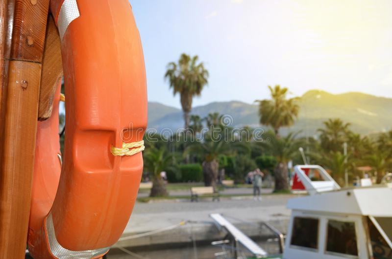 Orange life ring, side view. The concept of marine tourism, insurance and security royalty free stock photography