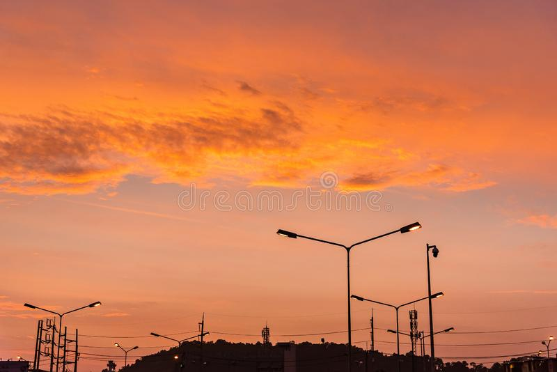 Orange light in morning sky with soft clouds at Thailand stock photo
