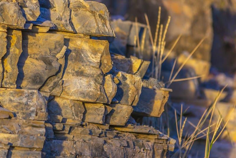 Orange light splashing on jagged rocks off trail stock photos