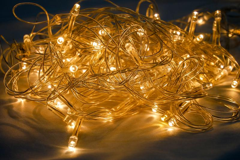 Orange lighting for adorn party. Lights, christmas, string, vector, background, isolated, garland, design, glowing, transparent, illustration, decoration stock photo