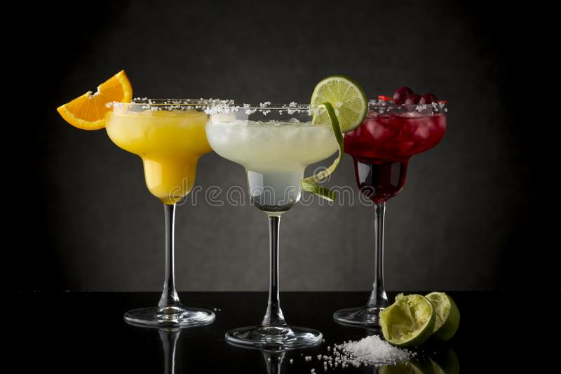 Orange, Lime and Cherry Margarita Cocktail stock images