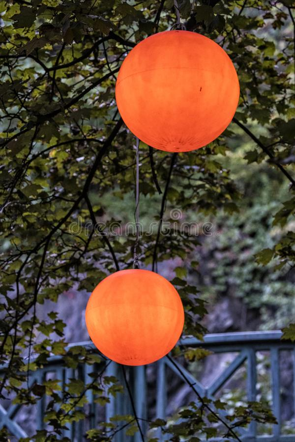 Orange lit lamp balls inside Quebec City Canada. At night royalty free stock image