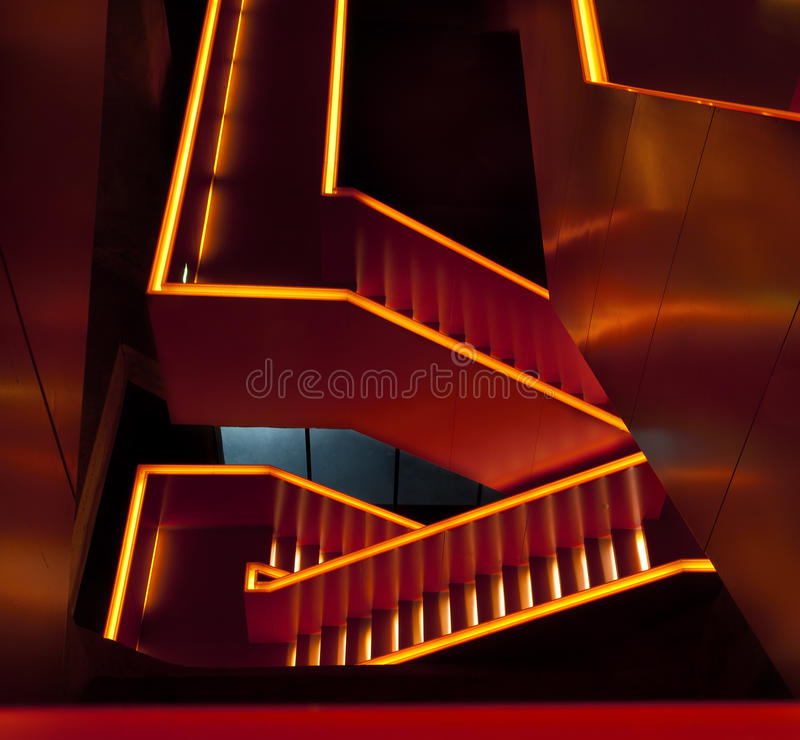 Orange lit staircase. Modern staircase at the entrance of the museum in Zollverein, an industrial heritage site in Essen, Germany, a former coal mine stock photography