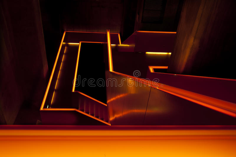 Orange lit staircase. Modern staircase at the entrance of the museum in Zollverein, an industrial heritage site in Essen, Germany, a former coal mine royalty free stock photos