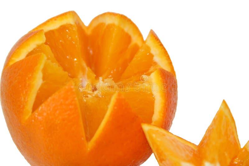 Orange ljust, soligt på en vit bakgrund arkivfoto
