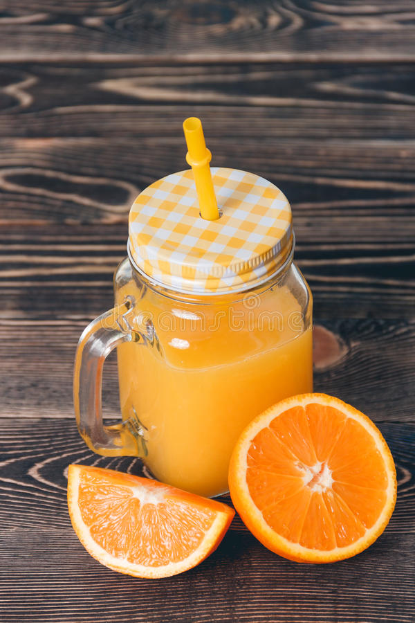 Orange, Lobule, Half, Juice. Healthy Lifestyle Concept. Orange, Half of Orange, Orange Lobule, Jar of Juice on the Wooden Table. Healthy Lifestyle Concept royalty free stock image