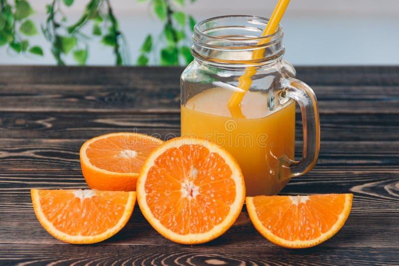 Orange, lobule, half of orange,. Orange, half of orange, orange lobule, jar of juice on the wooden table stock images