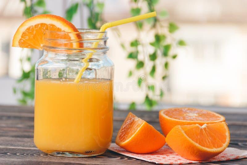Orange, Lobule, Juice. Healthy Lifestyle Concept. Orange, Orange Lobule, Jar of Juice on the Wooden Table. Healthy Lifestyle Concept royalty free stock photo