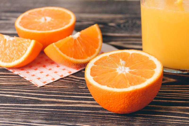Orange, Lobule, Juice. Healthy Lifestyle Concept. Orange, Orange Lobule, Jar of Juice on the Wooden Table. Healthy Lifestyle Concept royalty free stock photography