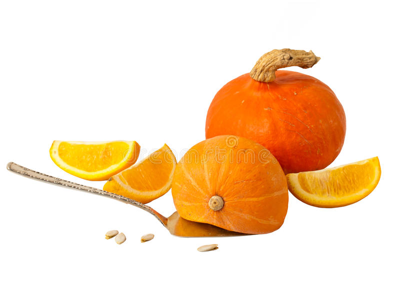 Orange lobules with pumpkin and sunflower seeds. Isolated on white stock photography