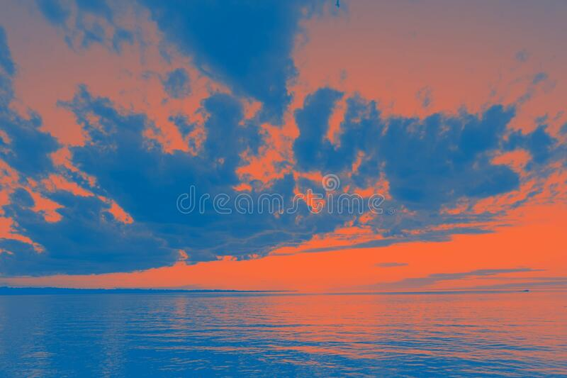 Orange lush lava and classic blue colors. Incredible sunset, toned. Photo royalty free stock photography