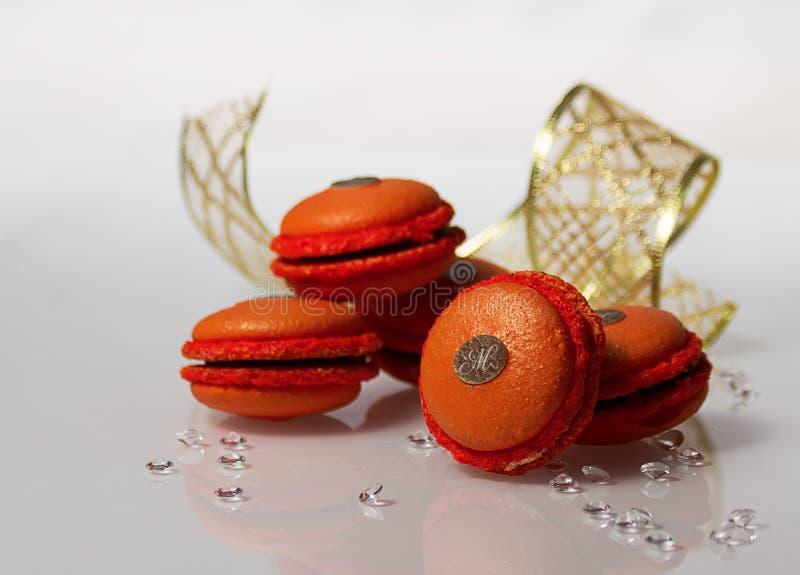 Orange macarons stockbild