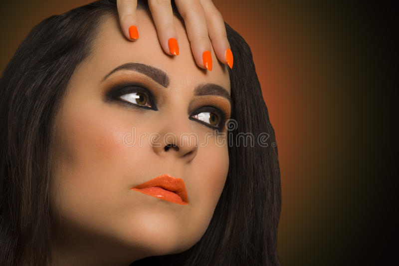 Orange make up. Beauty portrait about woman with orange make up royalty free stock images