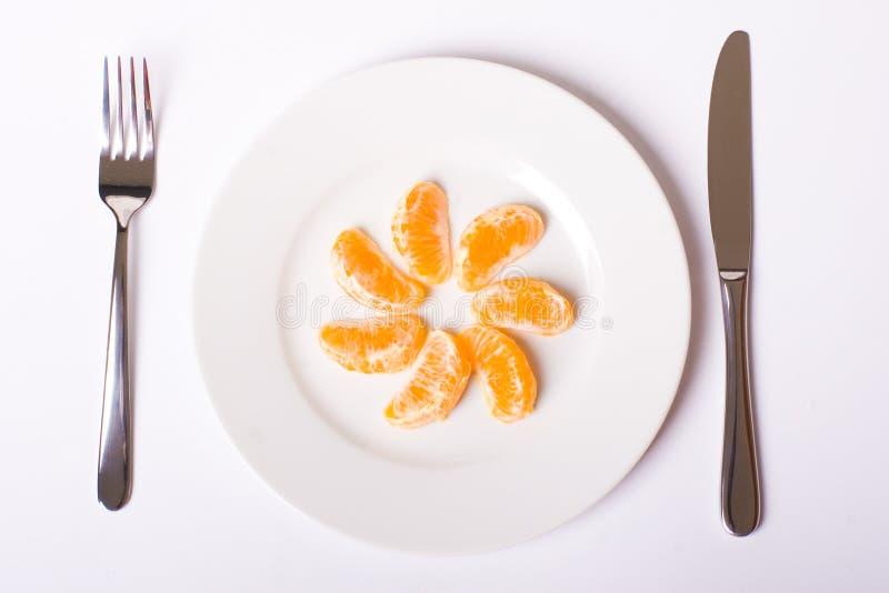 Download Orange Mandarin On White Plate Stock Photo - Image: 13213804
