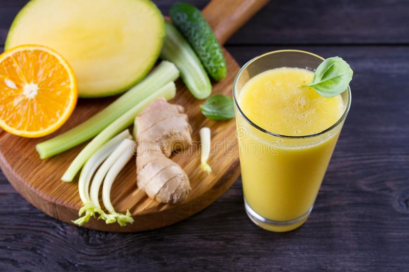 Orange Mango Ginger Smoothie. Fruit and Vegetable Smoothie - healthy diet and detox drink. royalty free stock image