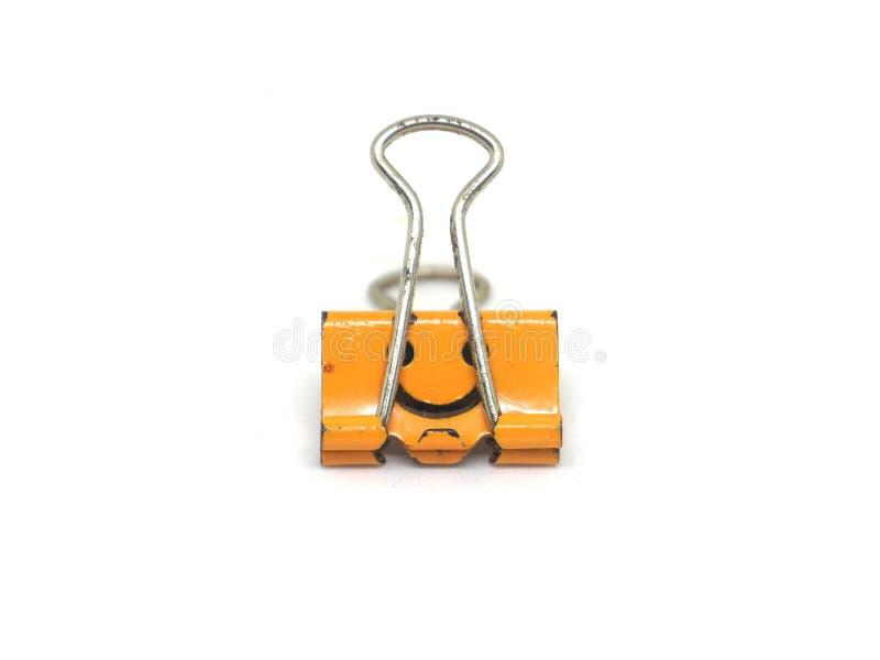 orange Mappenclipisolat auf Weiß lizenzfreie stockfotografie