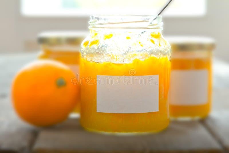 Orange marmalade jars soft focus royalty free stock photos