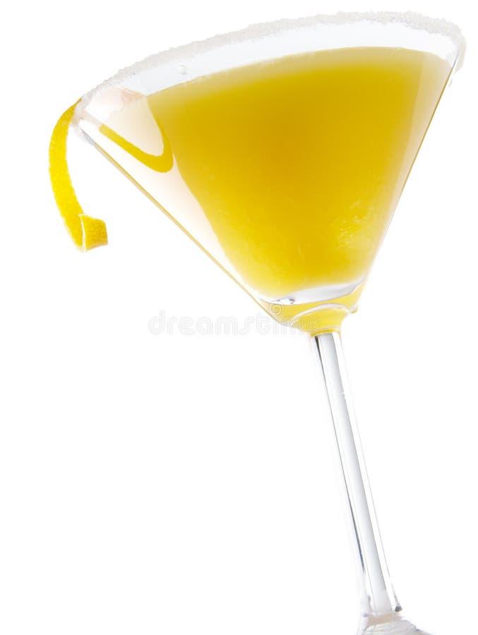 Orange Martini. Brightly lit orange martini on white background stock image