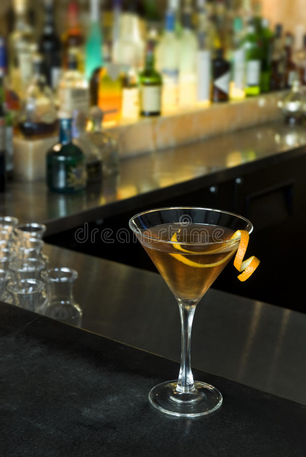 Orange Martini. An orange martini on a bar in a bar stock image