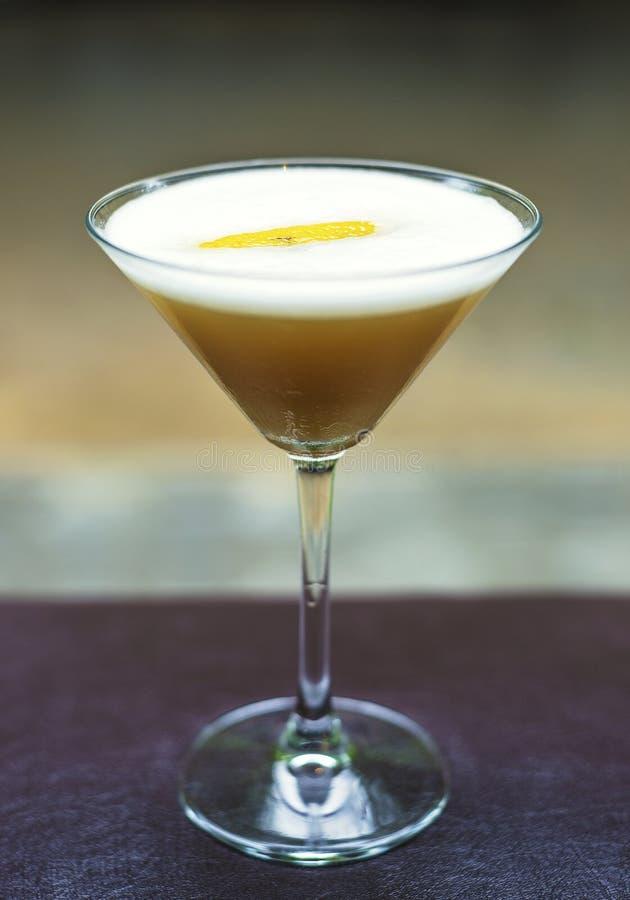 Orange martini alcoholic cocktail drink. Orange martini mix alcoholic cocktail drink royalty free stock images