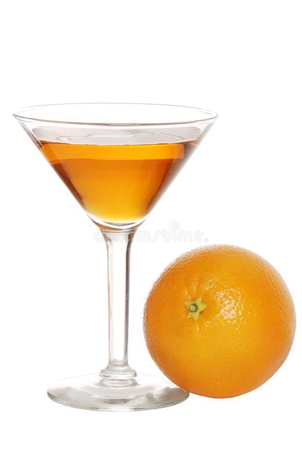 Orange martini with fruit. Isolated orange martini with fruit on a white background royalty free stock photos