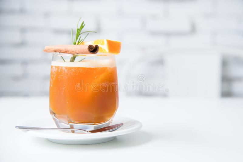 Orange mint soda mocktail with fresh orange.Soft focus of fresh mocktail drink in vintage coffee shop.Traditional summer drink stock photos