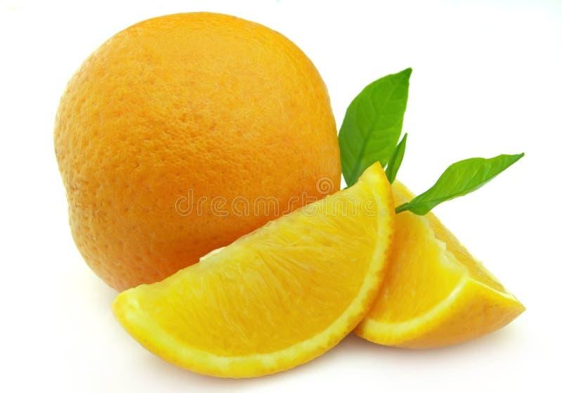 Orange mit Zweig stockfotos
