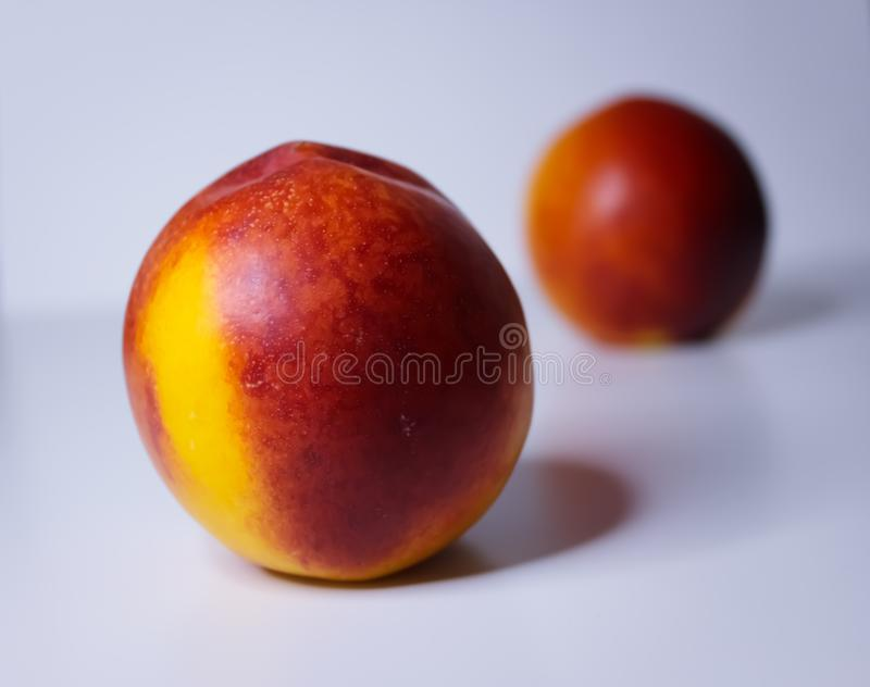 Orange nectarines on a white background. Ripe orange nectarines isolated on a white background stock photography