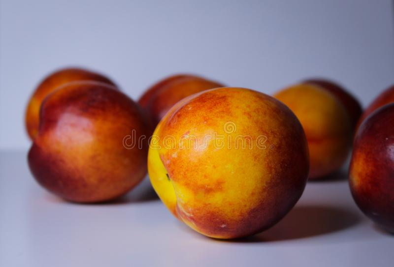 Orange nectarines on a white background. Ripe orange nectarines isolated on a white background stock photo