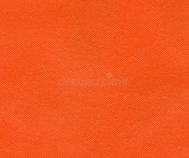Orange nonwoven polypropylene fabric texture background. Orange nonwoven polypropylene fabric texture useful as a background royalty free stock image