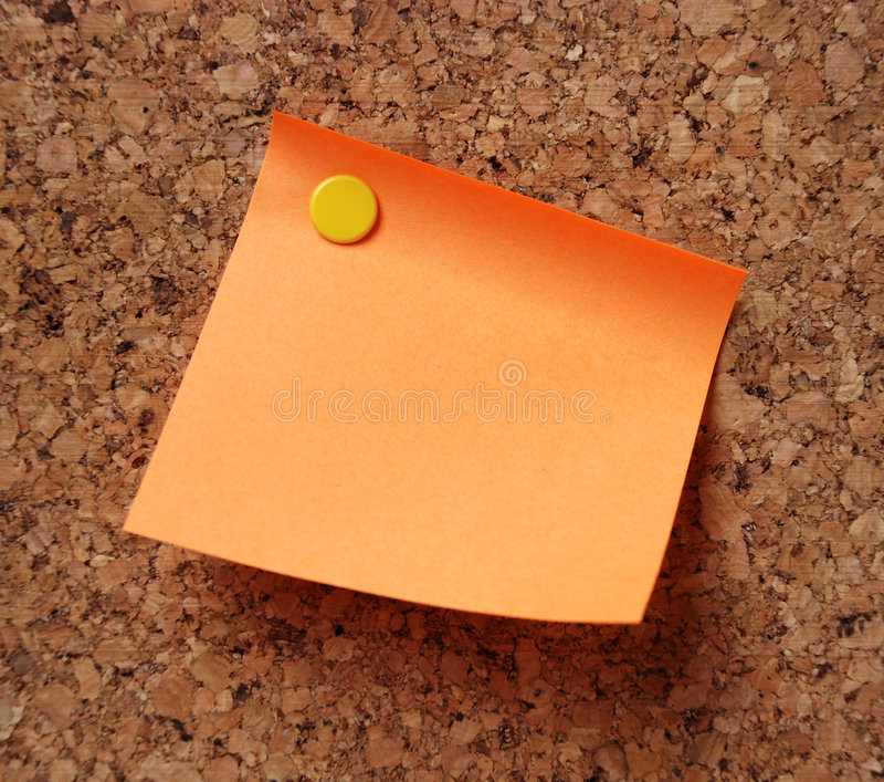 Orange note pad royalty free stock photography