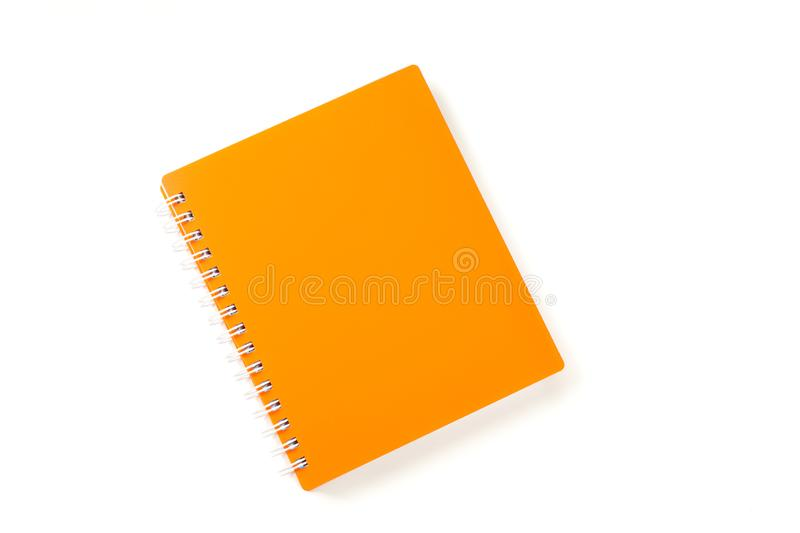 Orange notebook with space for text isolated on white background. Top view royalty free stock photo