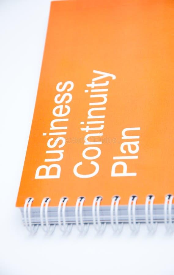 Orange notebook on a white backround royalty free stock photos