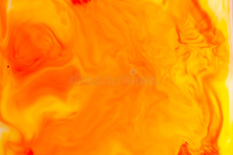 Orange oil paint on water abstract background stock photos