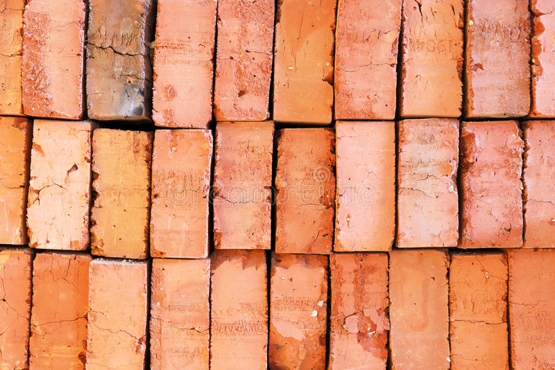 Orange old bricks layered on top of each other. In rows royalty free stock photography