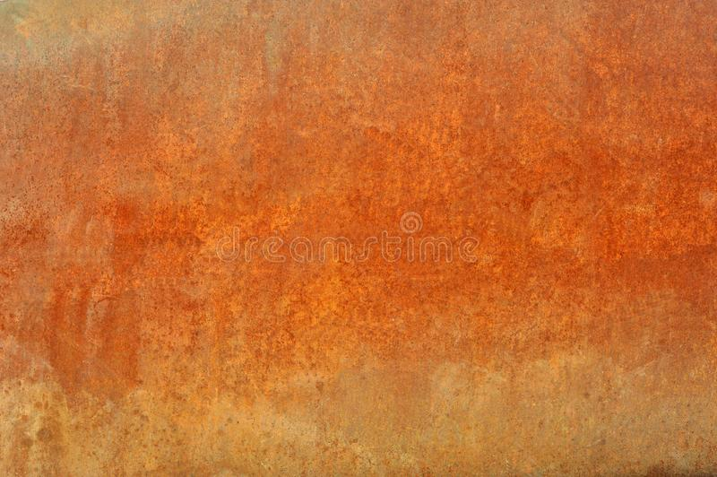Orange old rusted corroded metal or steel sheet. Orange brown old rusted corroded metal or steel sheet horizontal wall background as abstract dirty textured stock images
