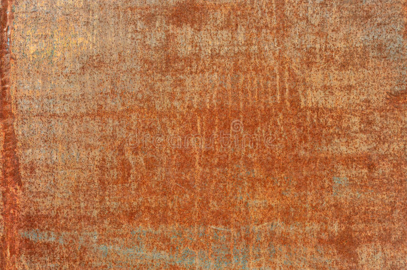 Orange old rusted corroded metal or steel sheet. Orange brown old rusted corroded metal or steel sheet horizontal wall background as abstract dirty textured stock photography