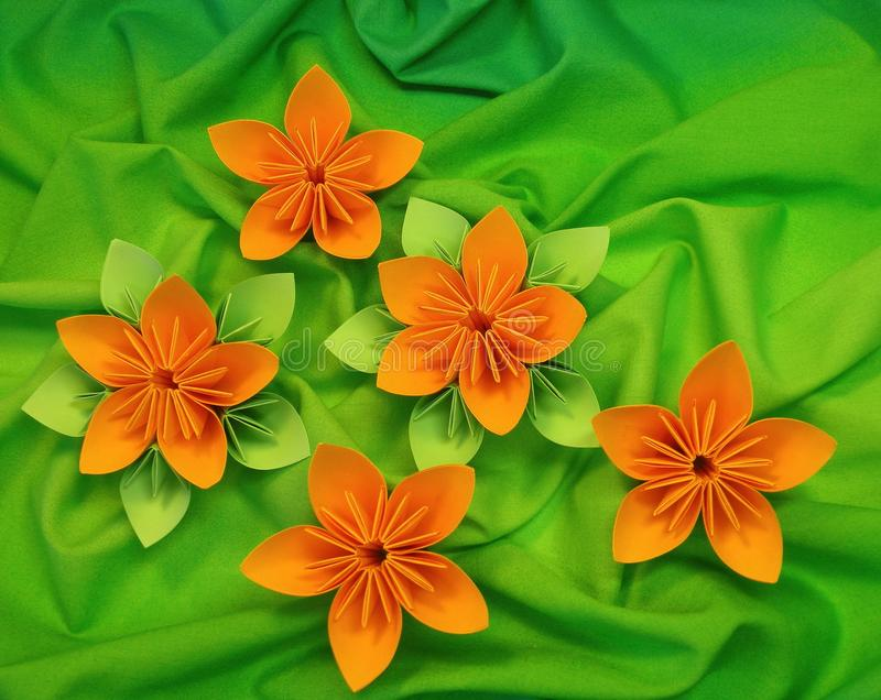 Orange origami flowers royalty free stock images