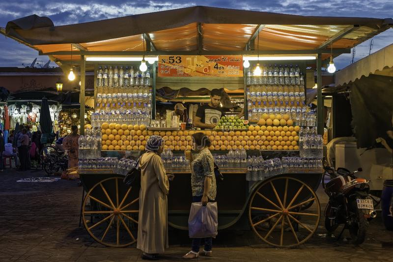 Orange and other fruit juices selling. Jeema el Fina square in Marrakech by night stock photo