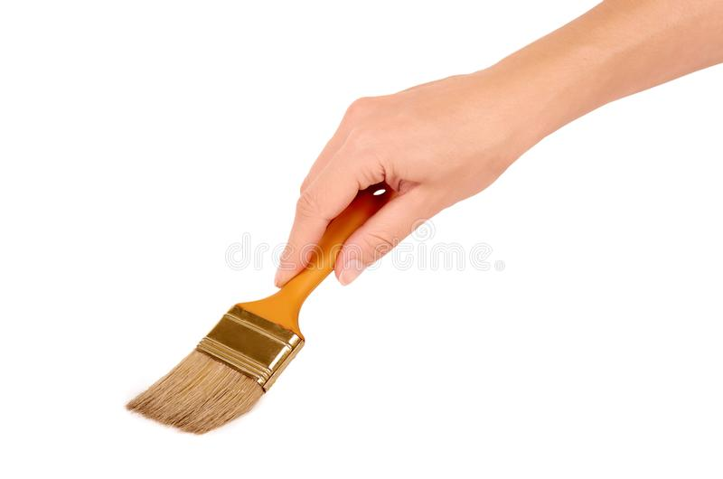 Orange Paint brush in hand isolated on white background stock image