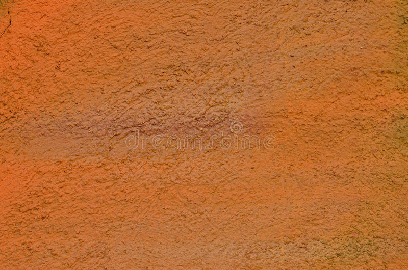 Orange paint texture. Texture of stucco coated wall airbrushed with orange graffiti paint royalty free stock images
