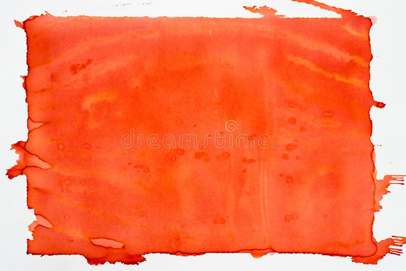 Orange painted watercolor background texture. Orange color painted watercolor on white paper background texture stock photography