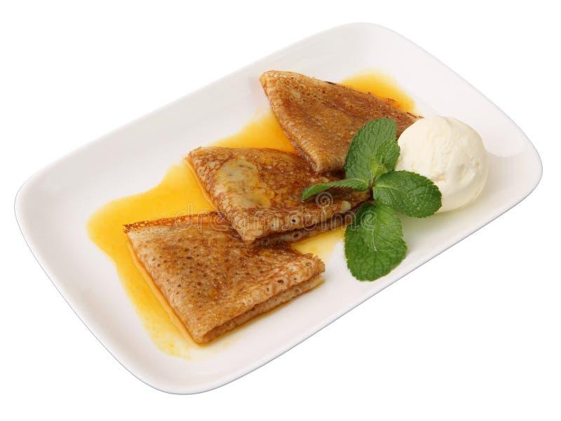 orange pannkakasås för kräm- is royaltyfria bilder