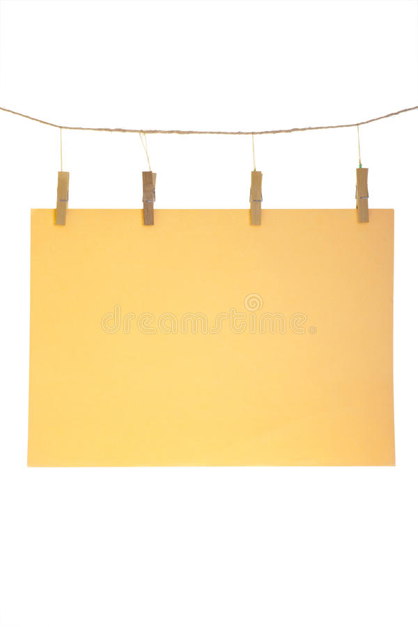 Orange paper sheet. Orange blank paper sheet on a clothes line. Isolated on white background stock photo