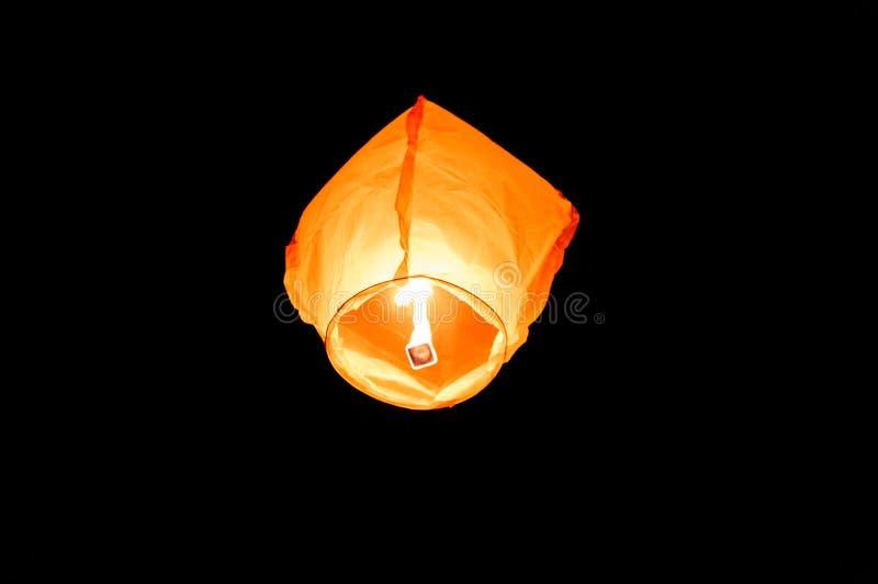 Orange paper sky flaming lantern, flying lantern, floating lantern stock photos
