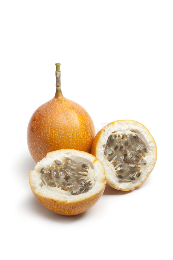 Orange passion fruit. Whole and partial orange passion fruit on white background royalty free stock photography