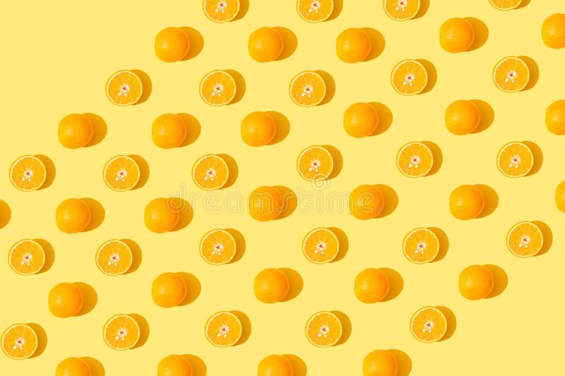 Orange pattern. Orange seamless pattern on yellow background royalty free stock photos